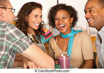 Friends Socializing - A group of friends are talking and...