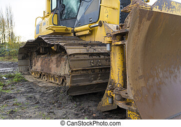 yellow excavator close-up