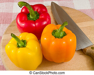Bell Peppers on a Wooden Cutting Board with Knife