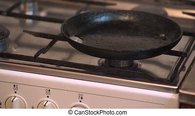 Pancake mixture being put into pan - Pancake mixture being...