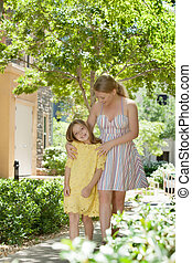 portraitof happy mother with daughter having good time in...