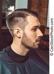 The young man in barbershop - The profile of young man with...