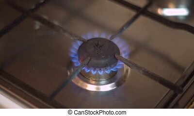 Gas burning from a stove - Gas burning from a kitchen stove