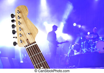 Guitar neck over concert stage