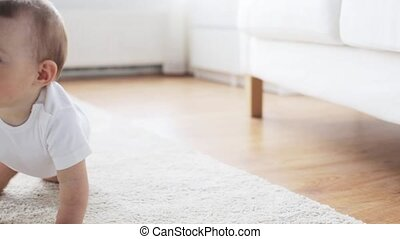 happy little baby crawling in living room at home 8 -...