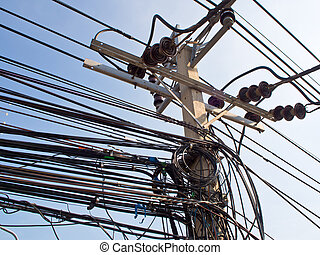 Tangled haywire Electric cable on Concrete Pole