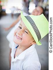 Cute boy in the hat cute winks