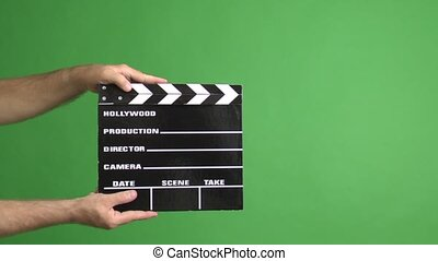 movie clapper on green screen