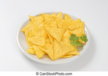 crunchy tortilla chips - triangle shaped tortilla chips on...