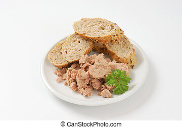 canned tuna with seeded roll - pieces of canned tuna served...