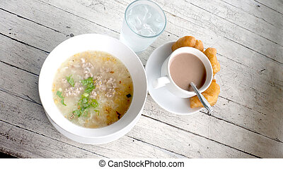 Boiled rice with Minced pork Thai Breakfast on white wood...