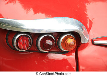 Detail of a vintage French car, backlights - three...