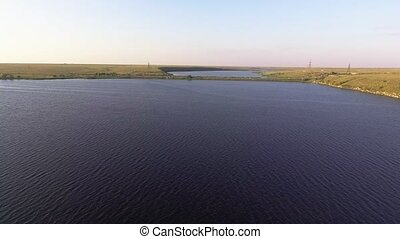 Flying over the big river. Aerial view from copter. 4K...