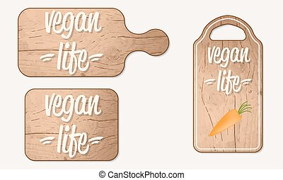 Wooden breadboard with the words vegan life