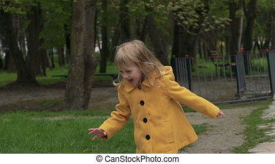 Smiling child running on the grass. Slowly