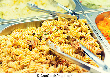 close up of pasta and dishes on catering tray - food,...