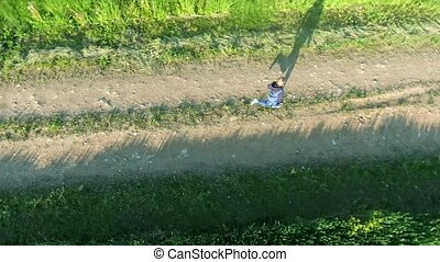 boy running in the fields aerial view - boy running in the...