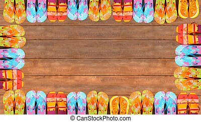 Brightly colored flip-flops on wood