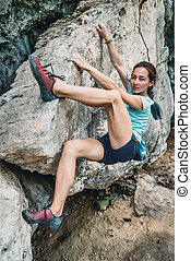 Rock bouldering outdoor - Beautiful sporty young woman...