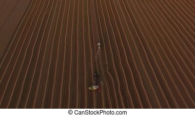 Flight over combaines harvesters threshing wheat - Flight...