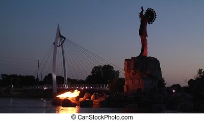keeper at night - keeper of the plains on the arkansas river...