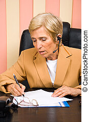 Senior sales representative taking notes - Senior sales...