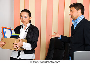 Fired disappointed woman - Disappointed woman holding box...