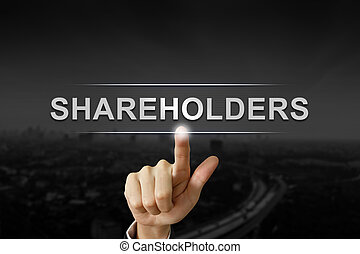 business hand shareholders mission button on black blurred...
