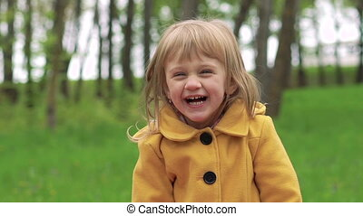 Baby girl smiling in the park. Slowly