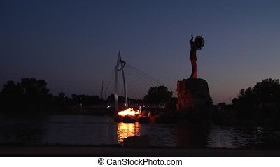 keeper at dusk - keeper of the plains on the arkansas river...