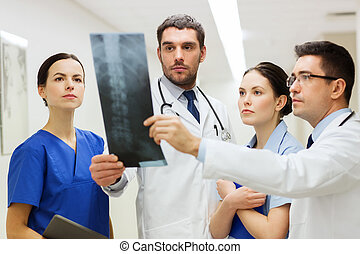 group of medics with spine x-ray scan at hospital - clinic,...