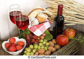 Wine and basket - Basket with food and red wine on a barrel