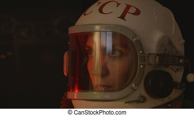 Attentive Female Cosmonaut - Female russian astronaut inside...
