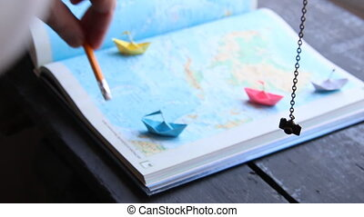 Travel to World. Tourism. Paper boats on the map.