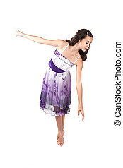 Young ballerina in pretty purple dress