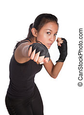 Beautiful young fitness trainer in combat pose