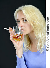 Blond woman drinking and smoking