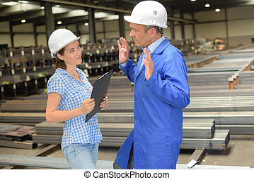 workers having a conversation