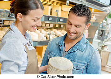 Giving advice in a cheese shop