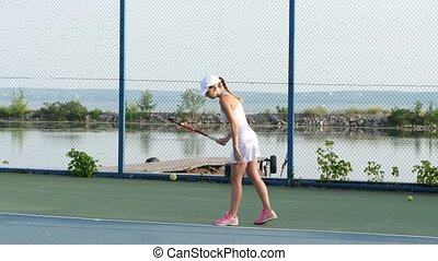Girl tennis player expecting the tennis ball, professional...