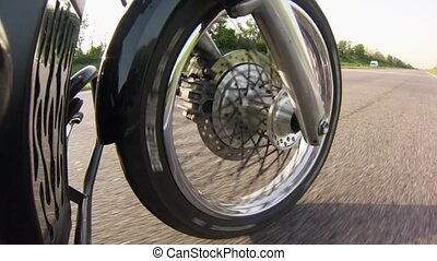Motorcycle wheel goes forward. Close up - Motorcycle wheel...