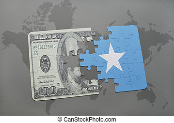 puzzle with the national flag of somalia and dollar banknote...