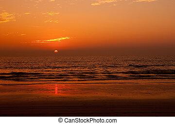 Sun setting over a tropical sea