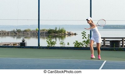 Women playing tennis. Outdoor courts - Tennis concept, girl...