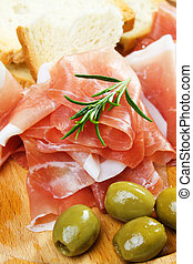 Prosciutto with bread and olive
