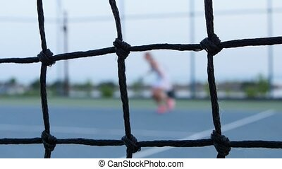 Tennis net in front. Tennis. Outdoor courts - Net in front,...