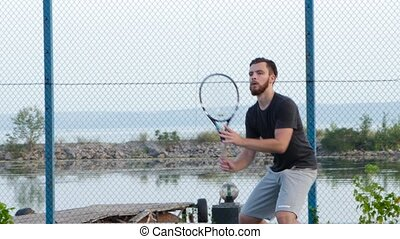 Male tennis player practicing tennis, professional tennis...
