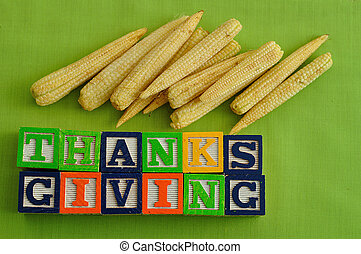 Thanks giving spelled with Alphabet blocks with corn against...