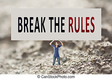 Break the rules, words on blank board hold by a young girl...
