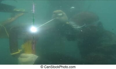 The man welding underwater